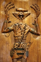 Carved Wooden Relief Depicting Candomble (Afro-Brazilian Religion) Orisha (divinity figure): by artist Carybe in the Afro-Brazilian Museum, Salvador, Bahia (photo)