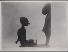 2 figurines: 1 standing and 1 seated