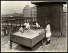 Blind girls playing in sand box on the roof of the New York Association for the Blind, 111 East 59th Street, New York, 1926 (silver gelatin print)