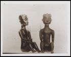2 figurines, a male and female seated