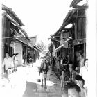 Asia Street Scene with Man Carrying Bucket, unidentified location, undated