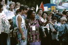 African Woman Shouting, Microphone Held in Front of her by Women from Scandinavian Radio Station, International Women's Tribune Centre Slide Show, NGO Forum, Huairou, China 30 August – 8 September, 1995