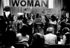 Photograph of Women with Signs at an International Women's Year Conference, 1977