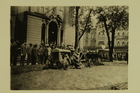 Photograph of a man on a tractor plowing a library lot, Detroit, MI