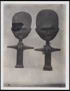 2 female figurines stylised with enlarged heads
