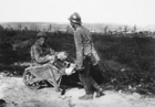 Captive French soldier helps his wounded comrade (b/w photo)