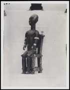 1 figurine seated on a chair