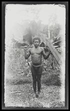 A bushman standing holding an axe and shield; full face; Rubiana Lagoon, New Georgia Island.
