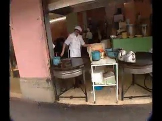 Man Cooking in a Street Kitchen