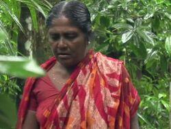 Documentary subject Ranjita Mandal walking near her home